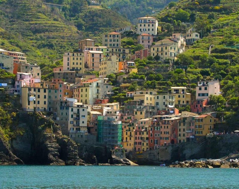 view of Riomaggiore in the Cinque Terre from the ferry.