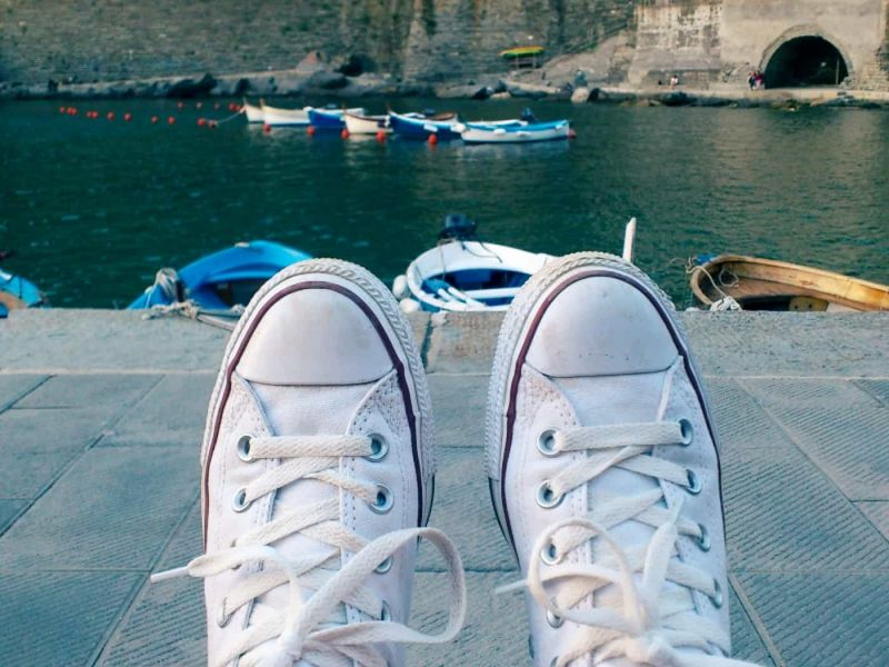 White Converse by Vernazza waterfront