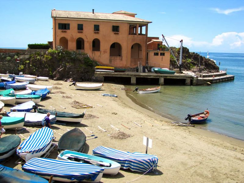 sandy beach and colourful boats at Levanto