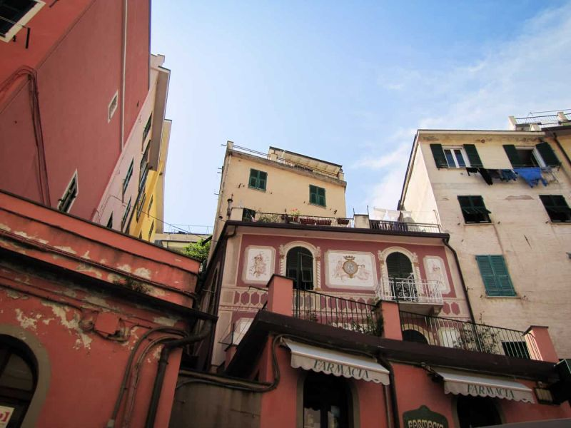view of the tall buildings of Riomaggiore from street level