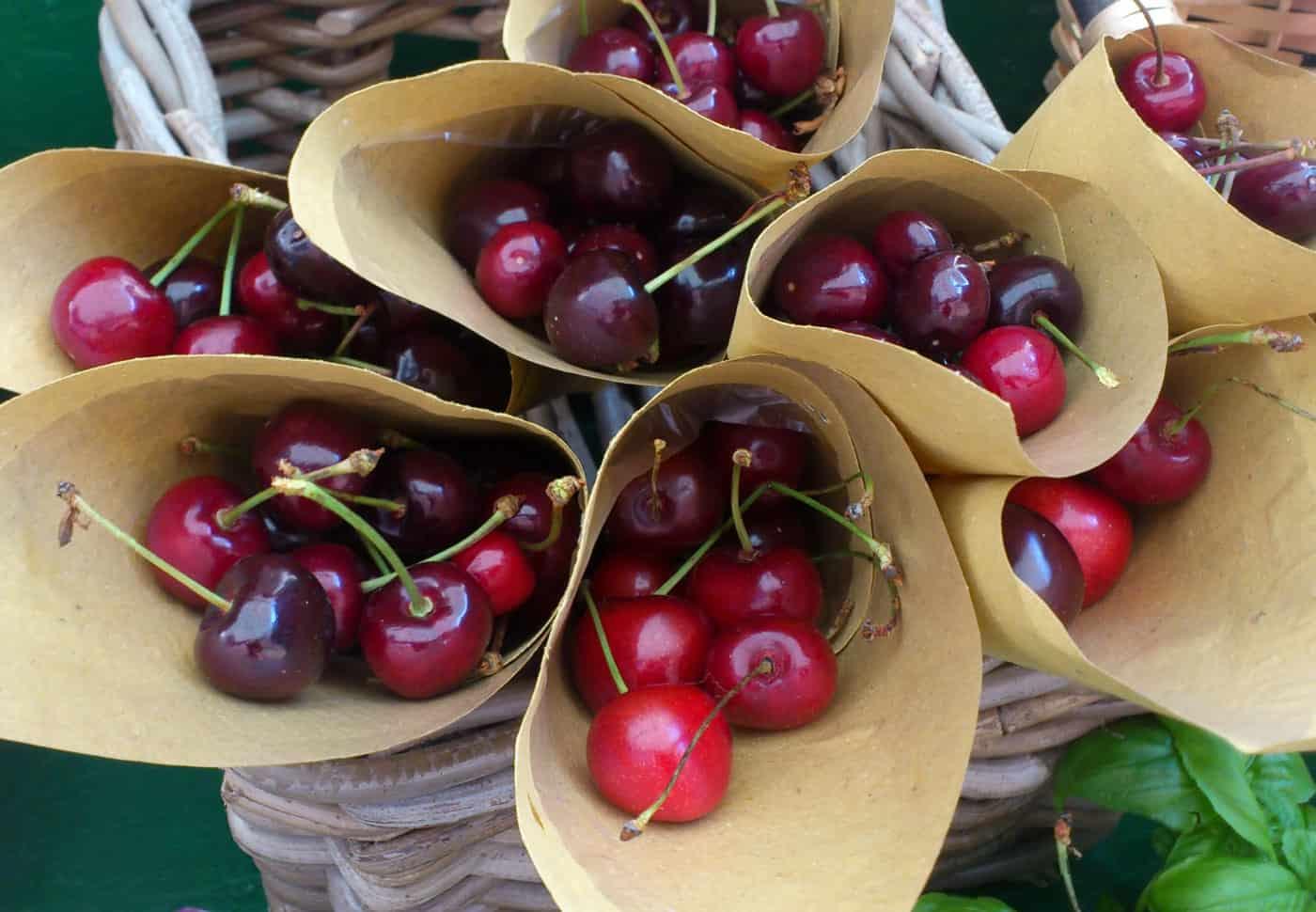 Cherries for sale in paper cones