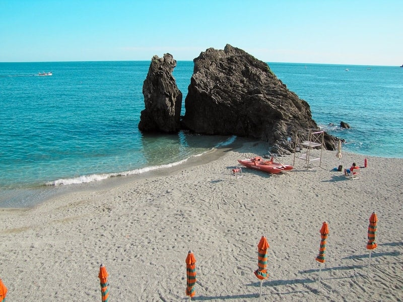 Monterosso beach, empty of crowds with lone lifeguard