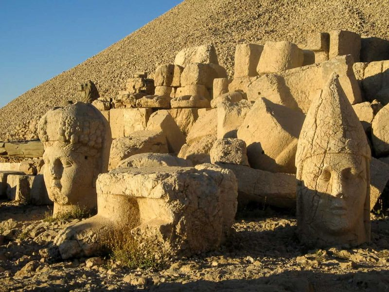 The heads of Mount Nemrut's West Terrace at sunset