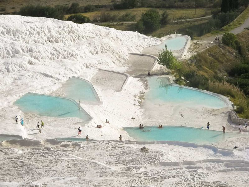 People bathing in Pamukkale's famous travertines.