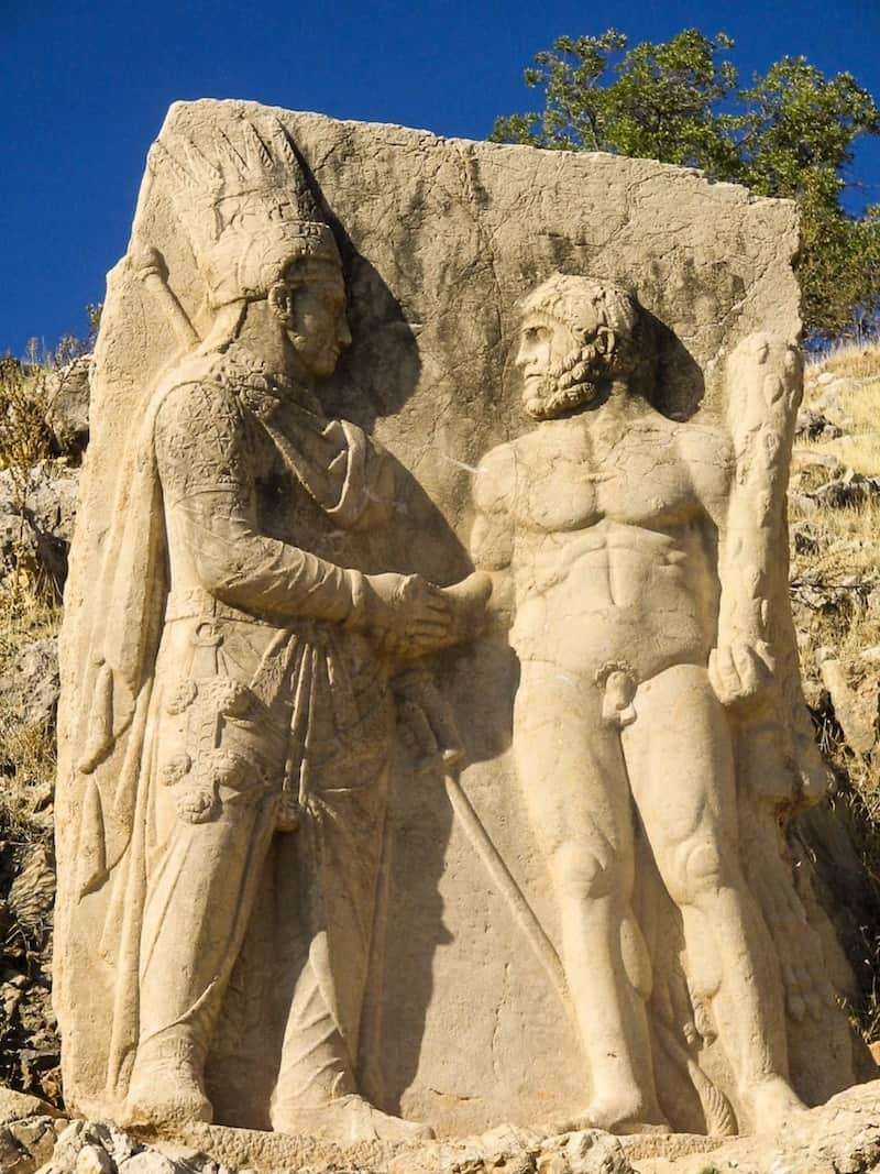 A relief carving of Antiochus shaking hands with Hercules at the site of Mount Nemrut