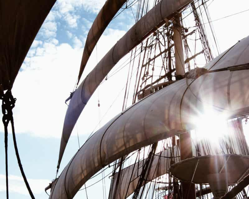 Tall ship Stavros S Niarchos with the sun shining behind the sails