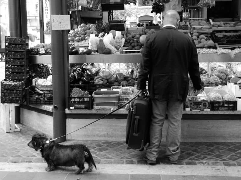 Man with a sausage dog in Rome