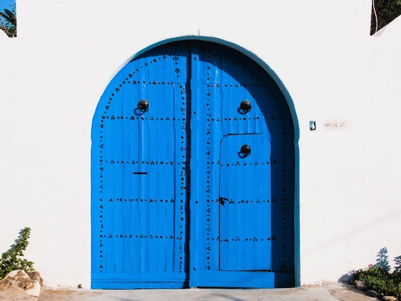 Blue door on white walls in Sidi Bou Said