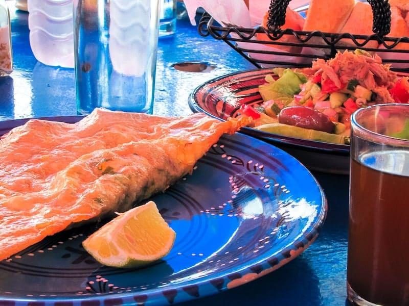 Brik and salad on traditional Tunisian ceramics
