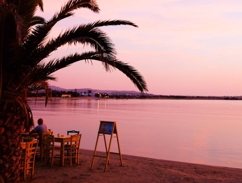 Dreamy pink sunset at Agios Georgios, the main town beach