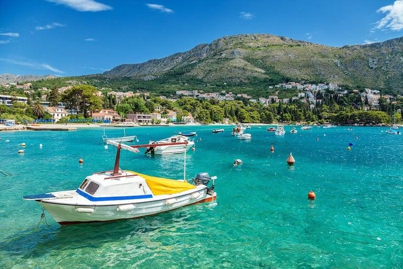A boat bobs in Mlini Bay, Dubrovnik