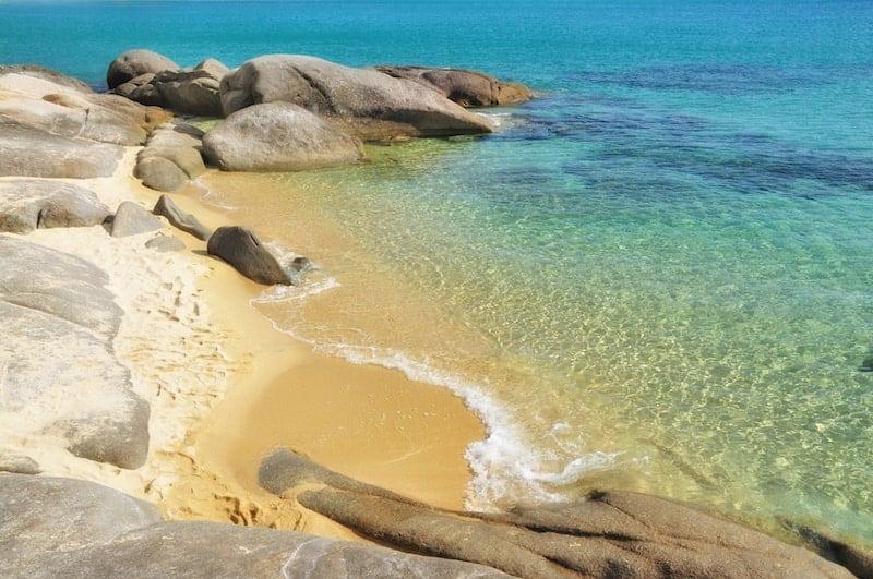Boulders and orange sand of Orange Beach in Sithonia