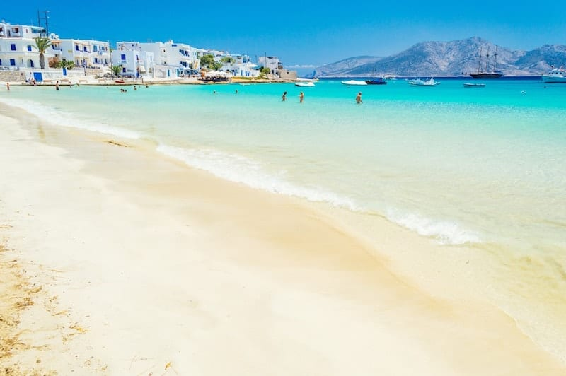White sandy beach with Koufonisia town in the background