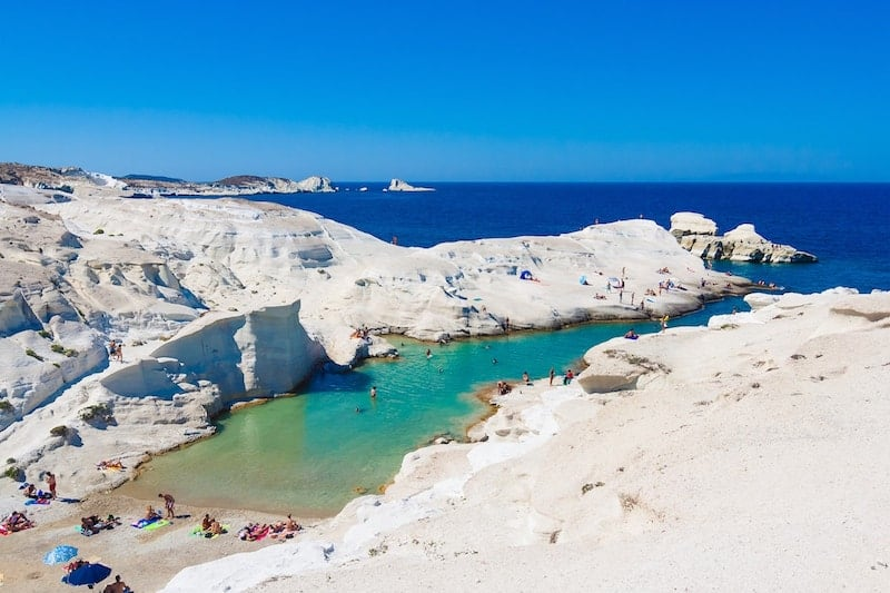 White rocks contrasting with turquoise waters on Sarakiniko beach, Milos