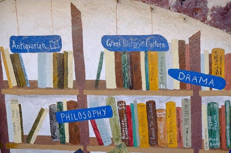 A painting of bookshelves in Atlantis Books, Oia