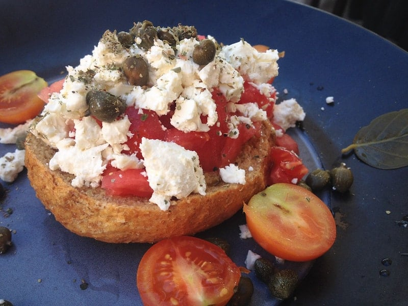 Dakos topped with tomatoes, feta and capers
