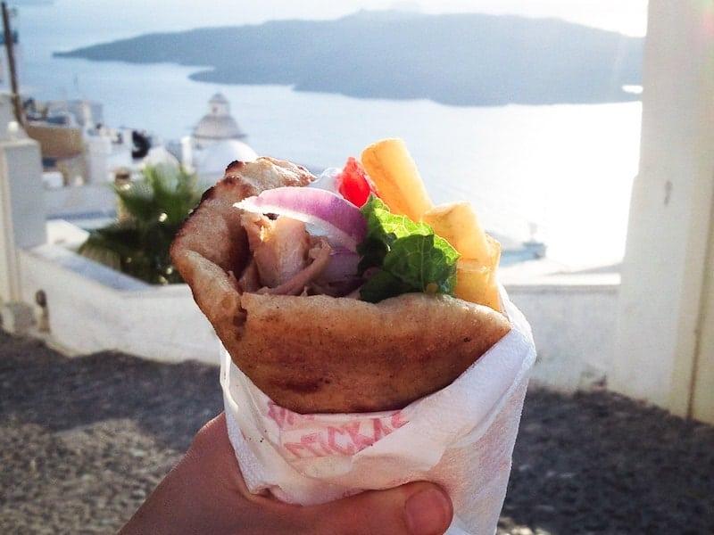 Pita gyros with a backdrop of Santorini