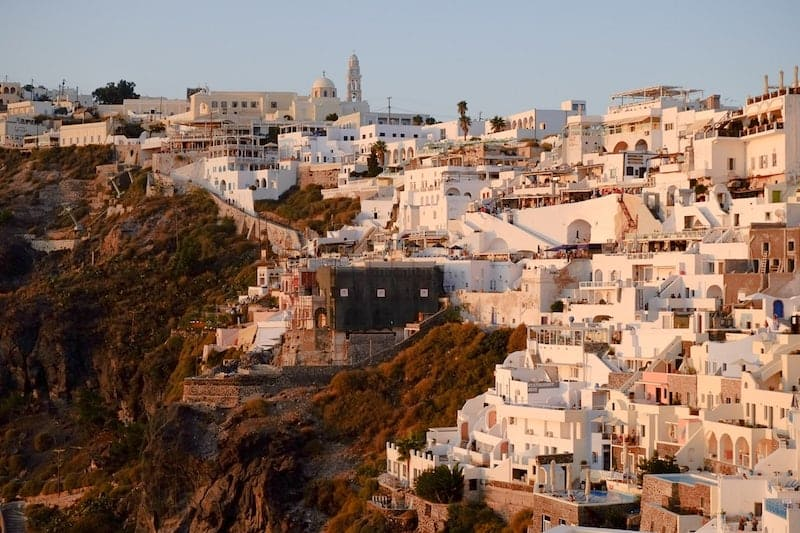The town of Fira, Santorini, bathed in golden light