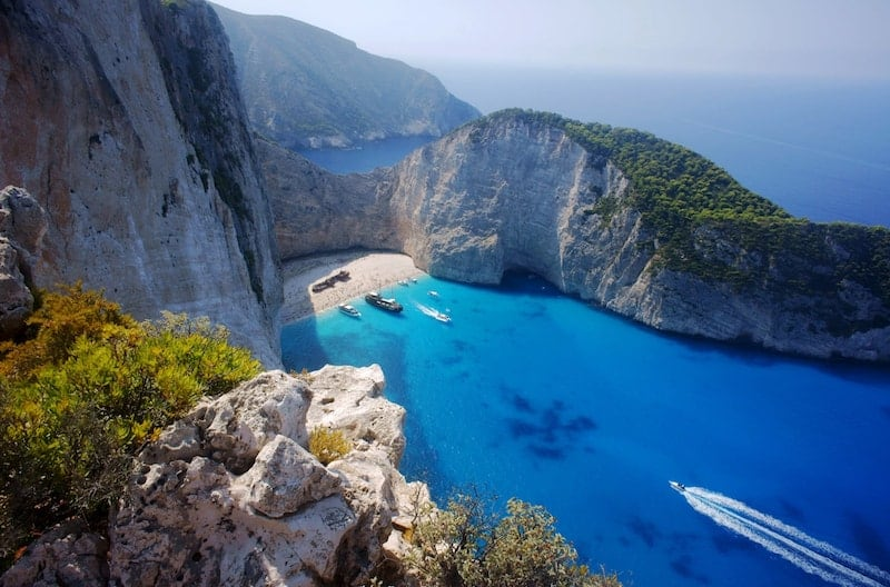 Trees top the steep cliffs around Shipwreck Beach, Zakynthos