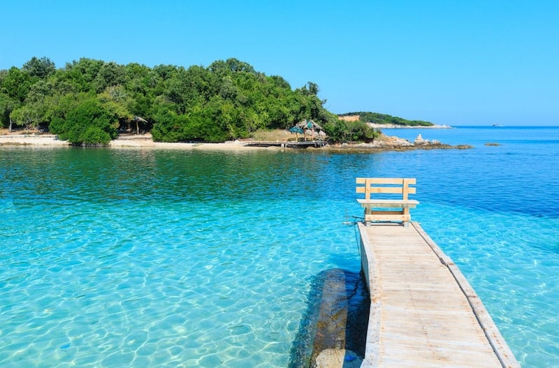 The famous Ksamil jetty leads to crystal clear waters