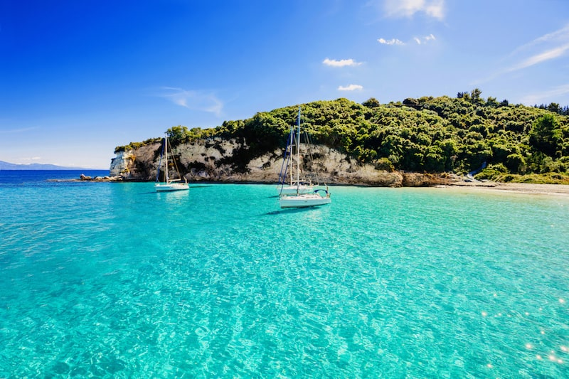 Pines and turquoise water on Paxos