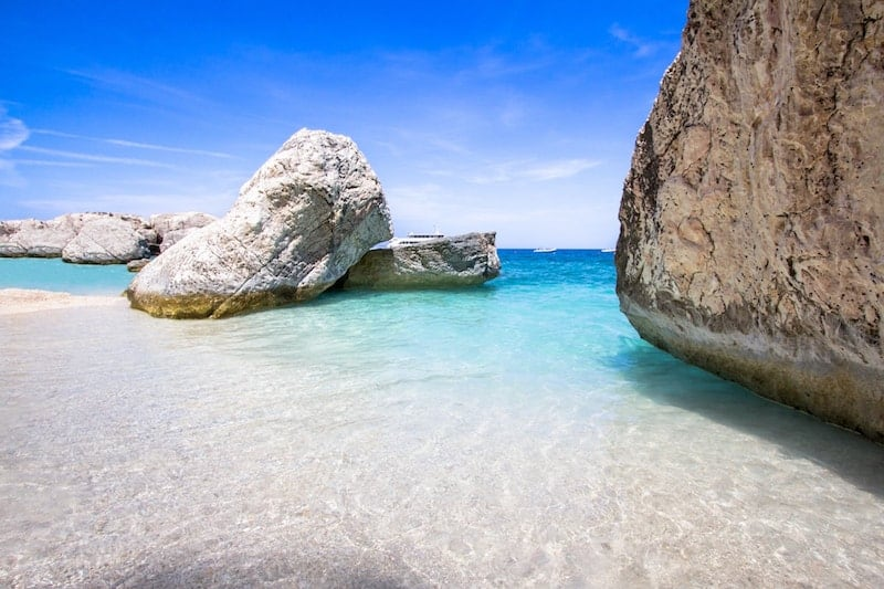 Large rocks and turquoise waters of Cala Mariolu in Sardinia
