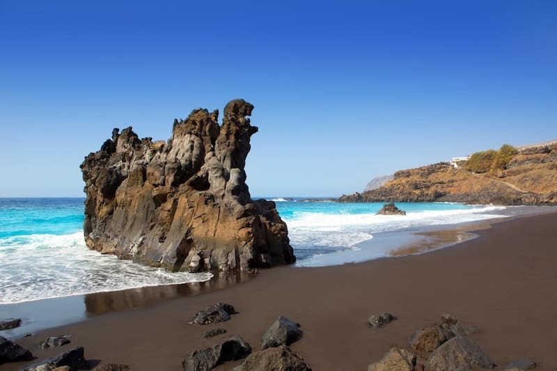 The black sands and rocks of El Bollullo Beach, Tenerife