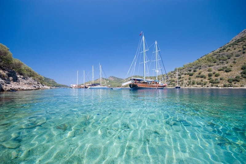 A gulet anchored in turquoise waters in Turkey