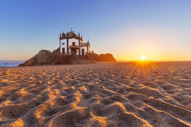 The sun sets on Praia de Miramar, Portugal