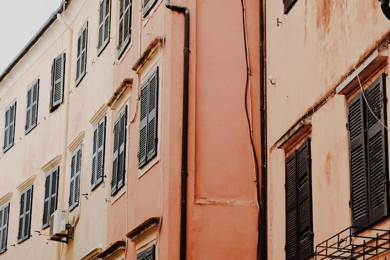 Orange and ochre buildings with green shutters, Corfu Town