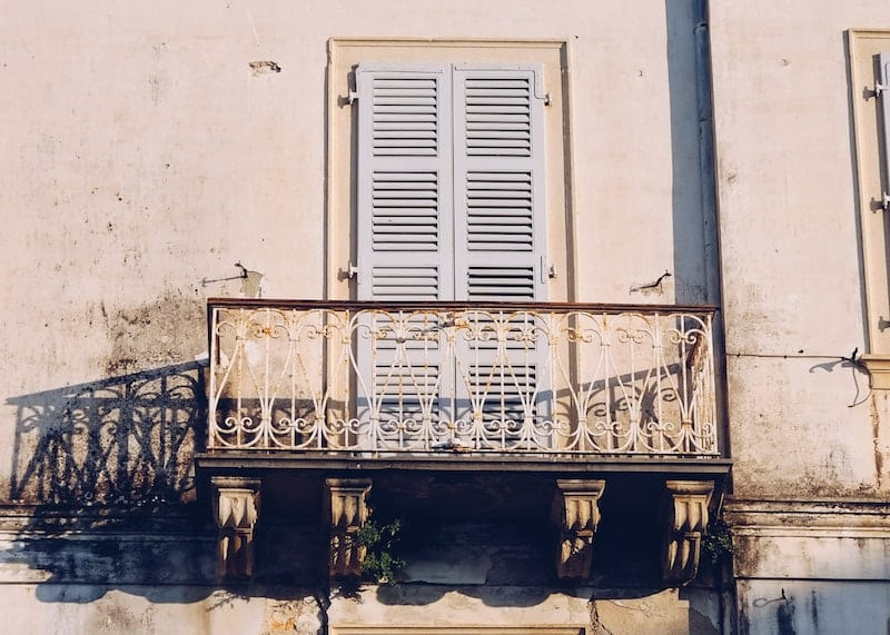 Ornate balcony casting a shadow, Corfu Old Town