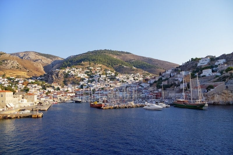 Sun casting shadows on Hydra harbour, Greece