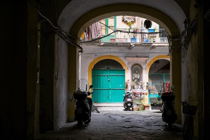 Icon, scooter and archway in Il Capo, Palermo