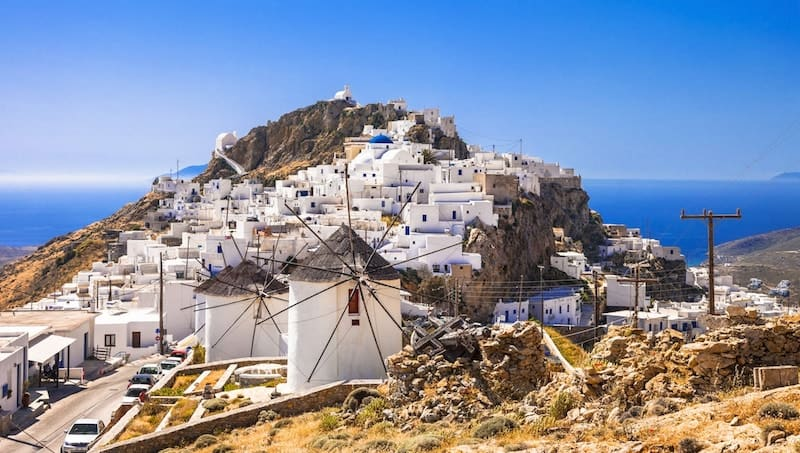 Windmills and white Cycladic buildings in Serifos Chora