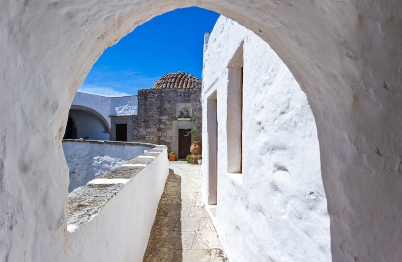 White archway and church in Patmos, Greece