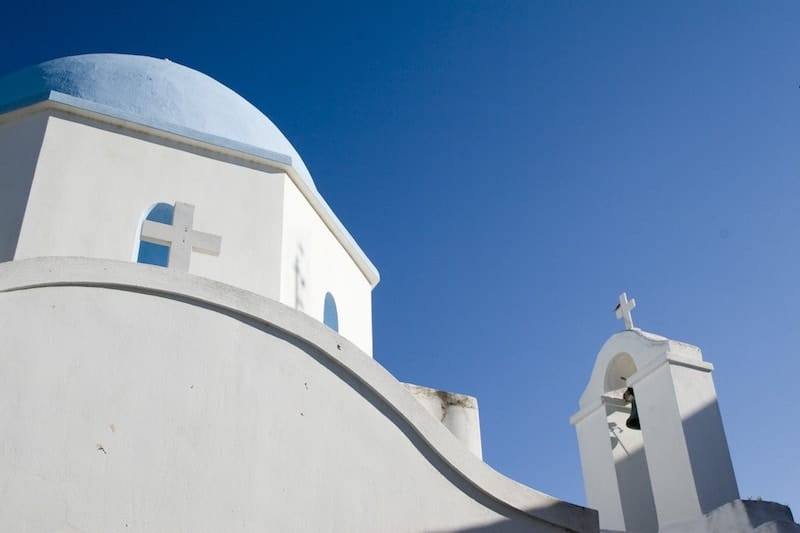 Graceful curves of a blue-domed Greek church