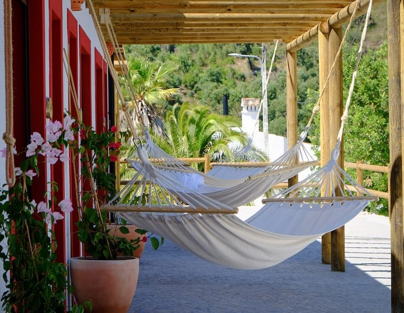Hammocks outside the guest rooms at Wild View Retreat