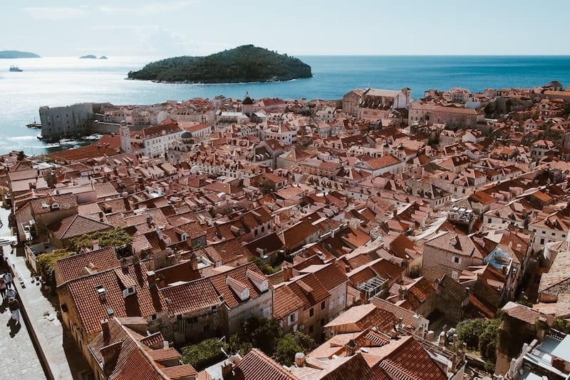 Red tiled roofs of Dubrovnik Old Town with Lokrum in the background