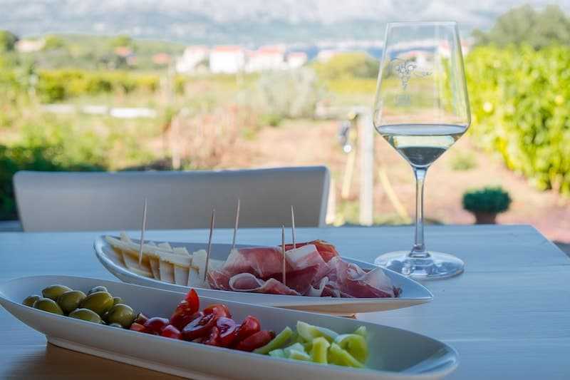 Grk wine and local charcuterie at vineyard on Korcula