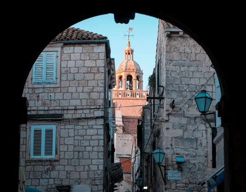 View through Revelin archway to the church tower