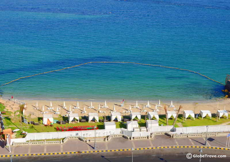 Aerial view of Alexandria beach with sun loungers