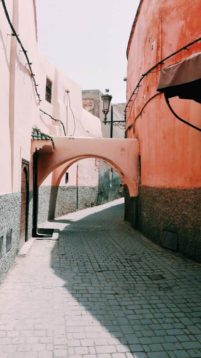 Pretty alley with arch in Marrakech medina