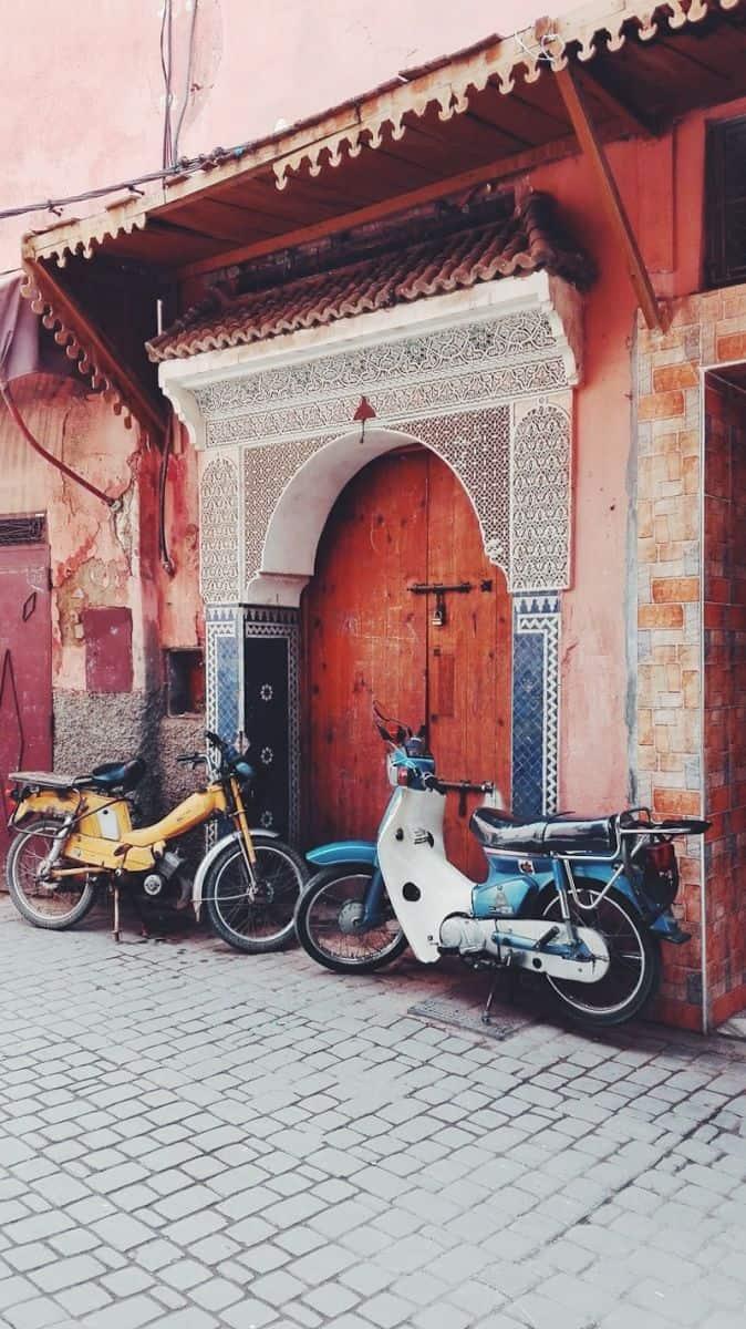 Bikes outside ornate doorway in Marrakech medina