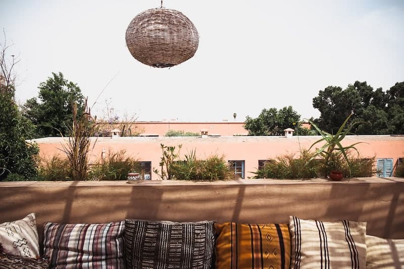 Rooftop terrace cafe with cushions