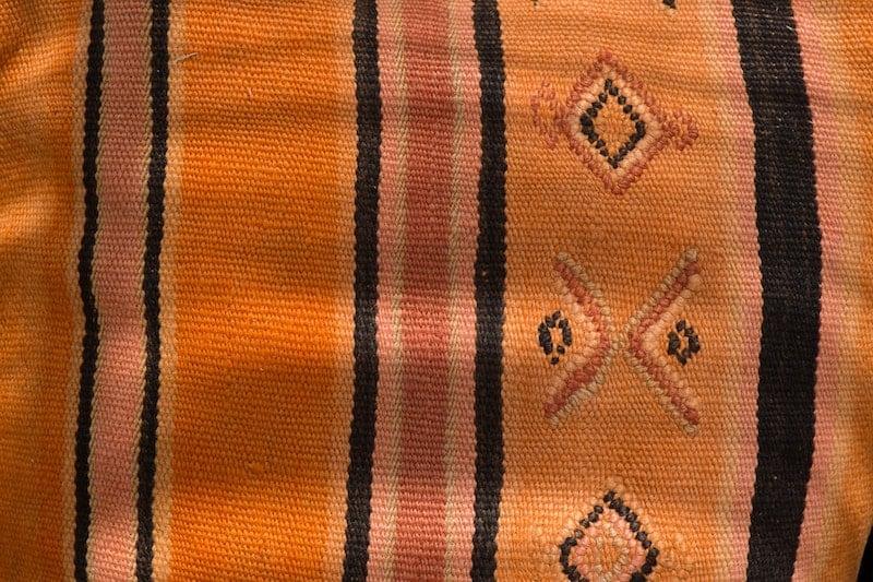Close up of bright orange cushion fabric