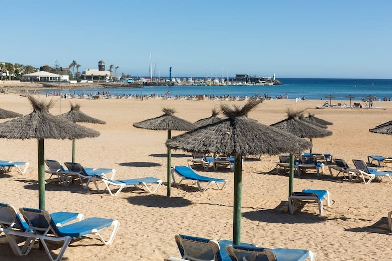 Sunloungers on the beach at Caleta de Fuste