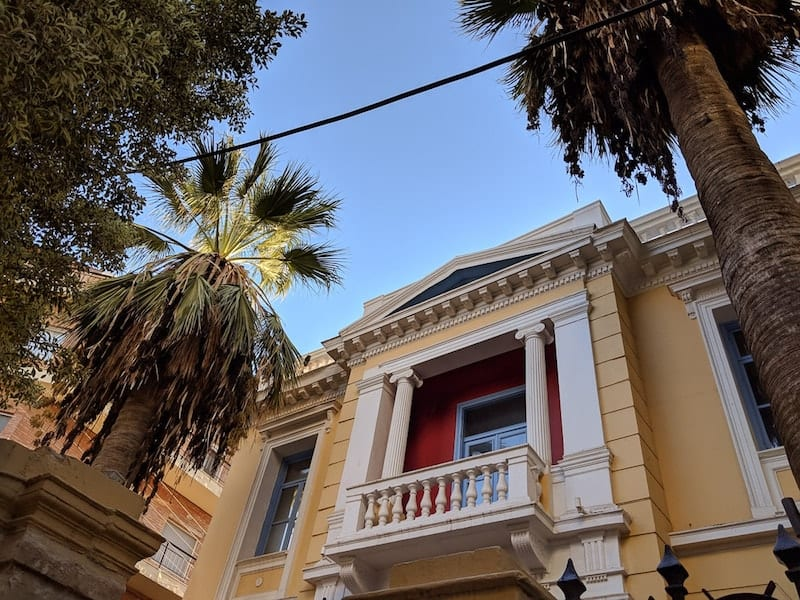 Neoclassic building and palms in Heraklion