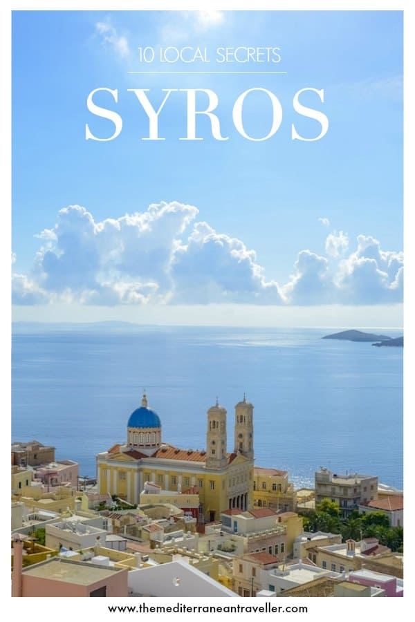 View of Syros' capital Ermoupoli with text overlay '10 Local Secrets - Syros'