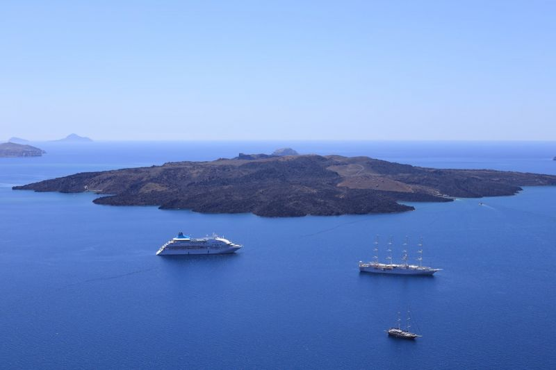 Ferry and ships near Santorini's volcanic crater