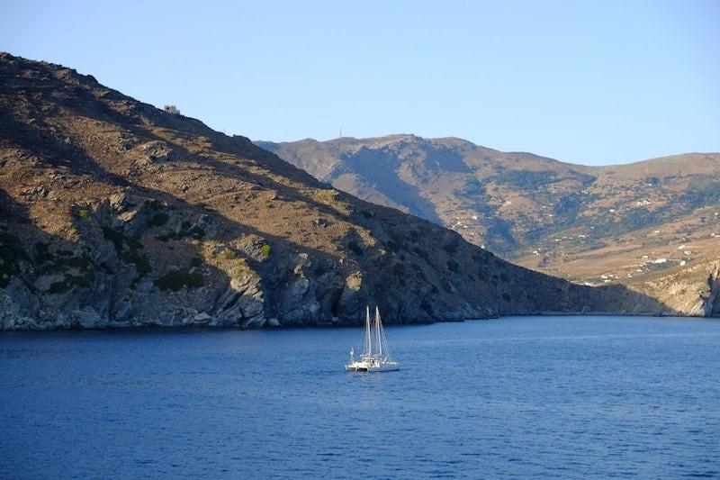 Catamaran against quiet Andros landscape